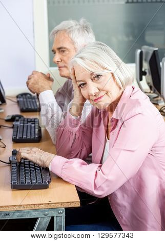 Smiling Senior Woman In Computer Class