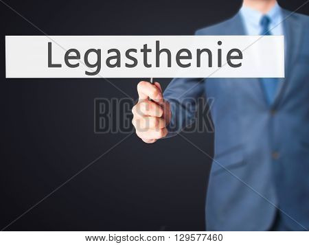 Legasthenie (dyslexia In German) - Businessman Hand Holding Sign