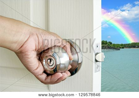 Left hand open the door isolated on nature background with clipping path.