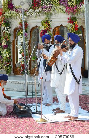 AMRITSAR INDIA - 30 OCTOBER 2015: Sikh Musicians perform at the Golden Temple. Sri Harmandir Sahib (The Abode of God) is the holiest Sikh gurdwara.