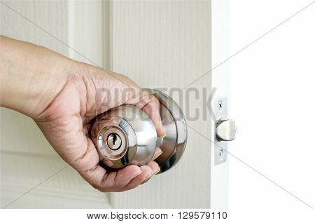 Left hand open the door isolated on white background with clipping path.