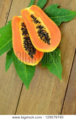 Ripe Papaya On Wood Background.