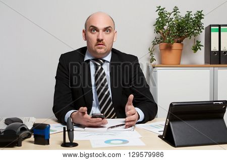 Consultant discusses a business plan. He gesticulates wildly