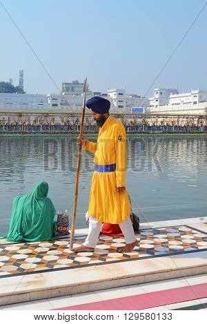 AMRITSAR INDIA - 30 OCTOBER 2015: Sikh guard at the Golden Temple. The Sri Harmandir Sahib (The Abode of God) is the holiest of Sikh gurdwaras.
