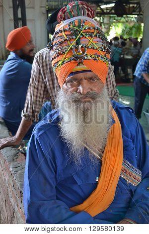AMRITSAR INDIA - 30 OCTOBER 2015: Sikh man with ornate Truban in the Sikh gurdwara Sri Harmandir Sahib (The abode of God).