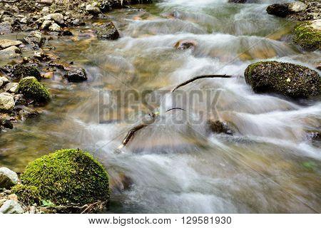 Water flowing over rocks in mountain stream in Zadiel Valley Slovakia