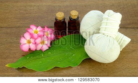 Thai style spa with herbal compress ball and aroma oil for relax muscle and skin treatment.