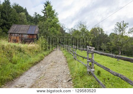 Wooden shed and fence near the red trail to the top of Luban, Poland