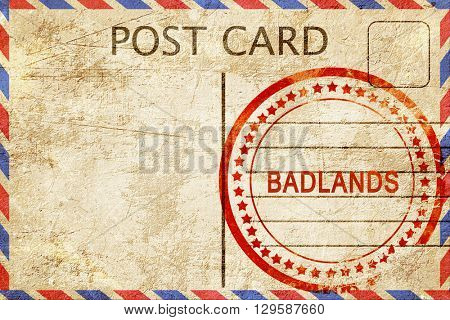 Badlands, vintage postcard with a rough rubber stamp
