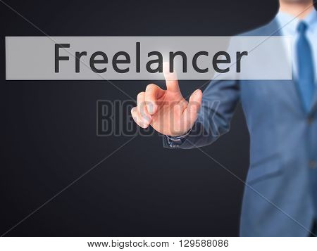 Freelancer - Businessman Hand Pressing Button On Touch Screen Interface.