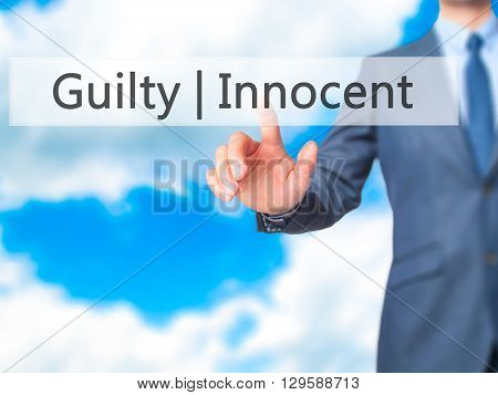 Guilty Innocent - Businessman Hand Pressing Button On Touch Screen Interface.