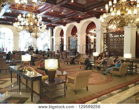 MANILA PHILIPPINES - APRIL 2 2016: Manila Hotel Lobby. Guests gather in the lobby of the iconic hotel.