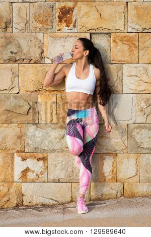 Fitness Muscular Woman Resting And Drinking Water