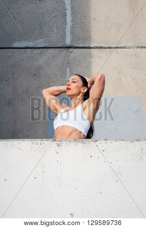 Tired Muscular Fitness Woman Resting After Urban Workout
