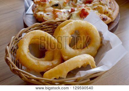Closeup Fried onion rings. Side Dish.Fast food