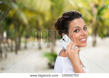Woman Calling On Smartphone During Caribbean Travel Vacation