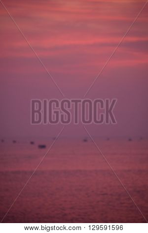 Abstract nature background. Blur moody pink purple clouds and sun set sky