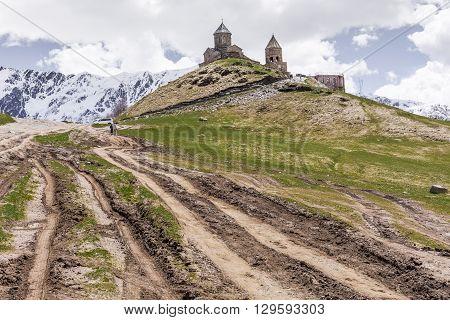 Georgia Stepantsminda-Sameba. Ancient Gergeti Trinity Church high in the mountains.