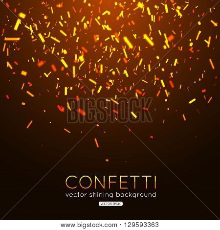 Gold confetti on dark background. Falling and glowing confetti. Vector illustration