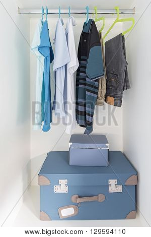 Kid's White Wardrobe With Shirts And Pants Hanging