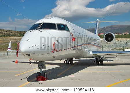 Gelendzhik Russia - September 10 2010: Bombardier Canadair CRJ 200 regional passenger jet plane at the airport in sunmmer