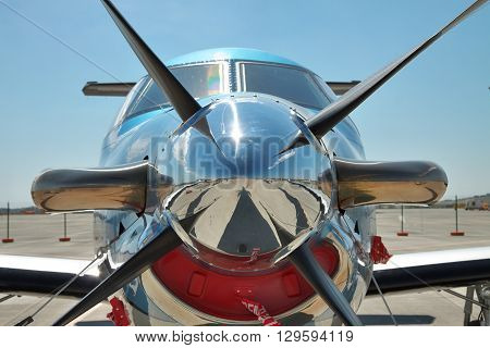 Gelendzhik Russia - September 10 2010: Pilatus PC-12 light turboprop passenger plane on the apron in the airport - front view closeup