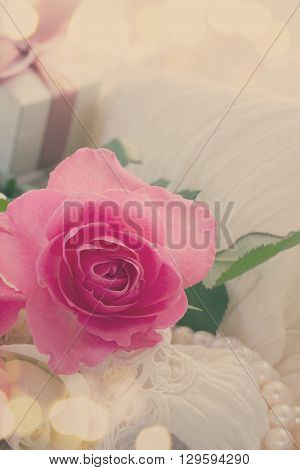 fresh pink  rose flower with lace and pearls, retro toned