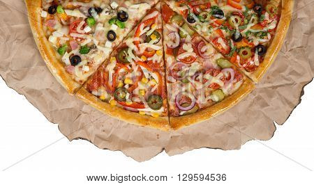 Assorted pizzas on paper on a white background isolated.