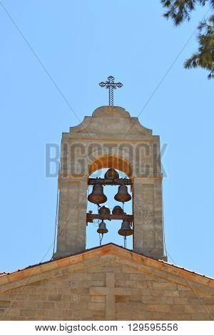 Bell tower at Saint George Greek Orthodox Church in Madaba Jordan.
