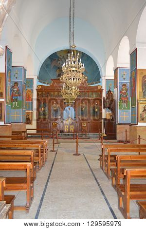 MADABA JORDAN - JULY 22 2015: Saint George Greek Orthodox Church Altar The Church is also know for the 6th century mosaic map of the region.