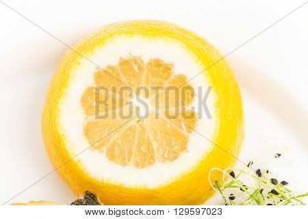 Closeup of sliced lemon for baked seabass. Macro. Photo can be used as a whole background.