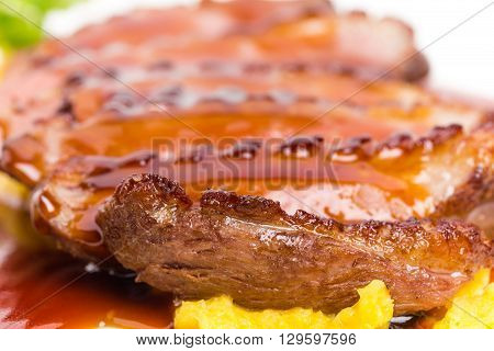 Delicious grilled duck breast on mango puree covered with red sauce. Macro. Photo can be used as a whole background.
