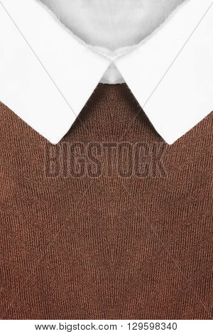 White shirt collar on brown pullover as a background
