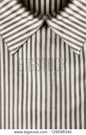 Striped satin blouse collar closeup as a background