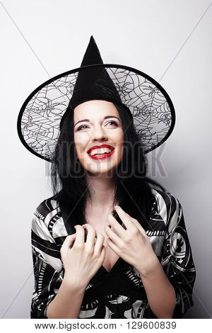 pretty young brunette witch with black hat