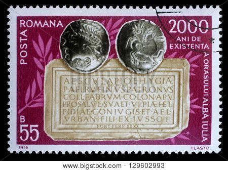 ZAGREB, CROATIA - JULY 18: a stamp printed in Romania shows Coins and tablet, 2,000 Years City of Alba Julia issue, circa 1975, on July 18, 2012, Zagreb, Croatia