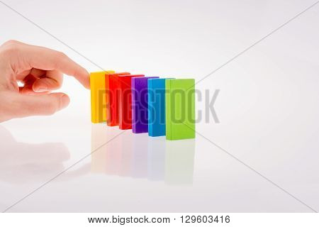multi color domino pieces on white background