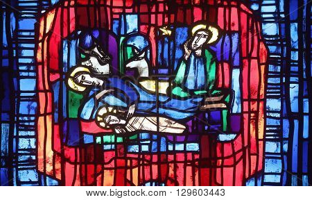 WASSERALFINGEN, GERMANY - MAY 07: Stained glass window in the parish church of St. Stephen in Wasseralfingen, Germany on May 07, 2014.