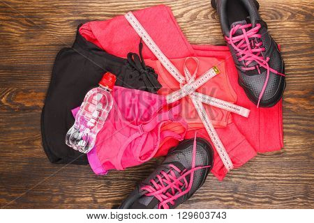 Different Sport Items On The Wooden Background