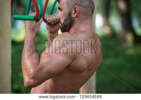 Man Doing Chin Ups A Street Workout