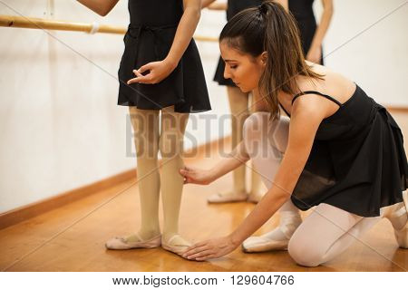 Dance Instructor Helping Girls With Posture