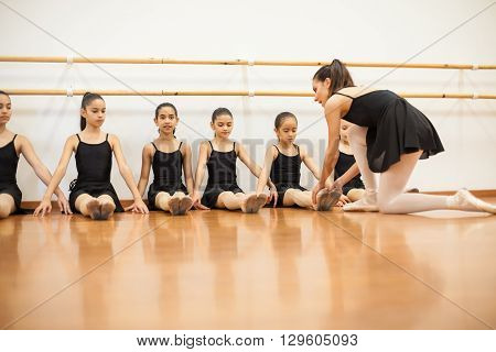 Dance Instructor Teaching A Ballet Class