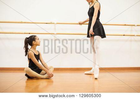 Little Girl Looking Up To Her Dance Teacher