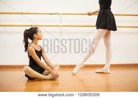 Dance Instructor Teaching A Little Girl