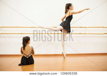 Girl Watching A Real Dancer Do Barre Work