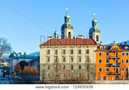 Austria Tyrol Innsbruck sunset view of the old palaces with the San Giacomo Cathedral towers on the Inn river bank