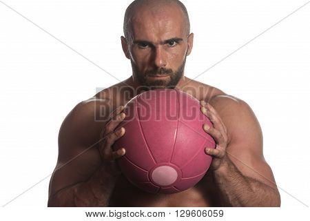 Man Workout With Ball Over White Background Isolated