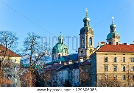 Austria Tyrol Innsbruck sunset view of the San Giacomo Cathedral towers on the Inn river bank