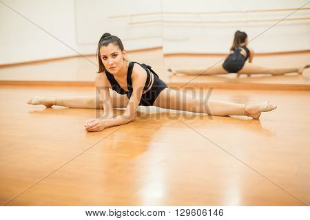 Cute Latin Dancer Doing A Leg Split