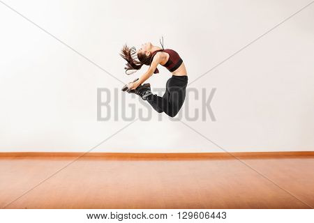 Female Jazz Dancer Jumping In A Studio